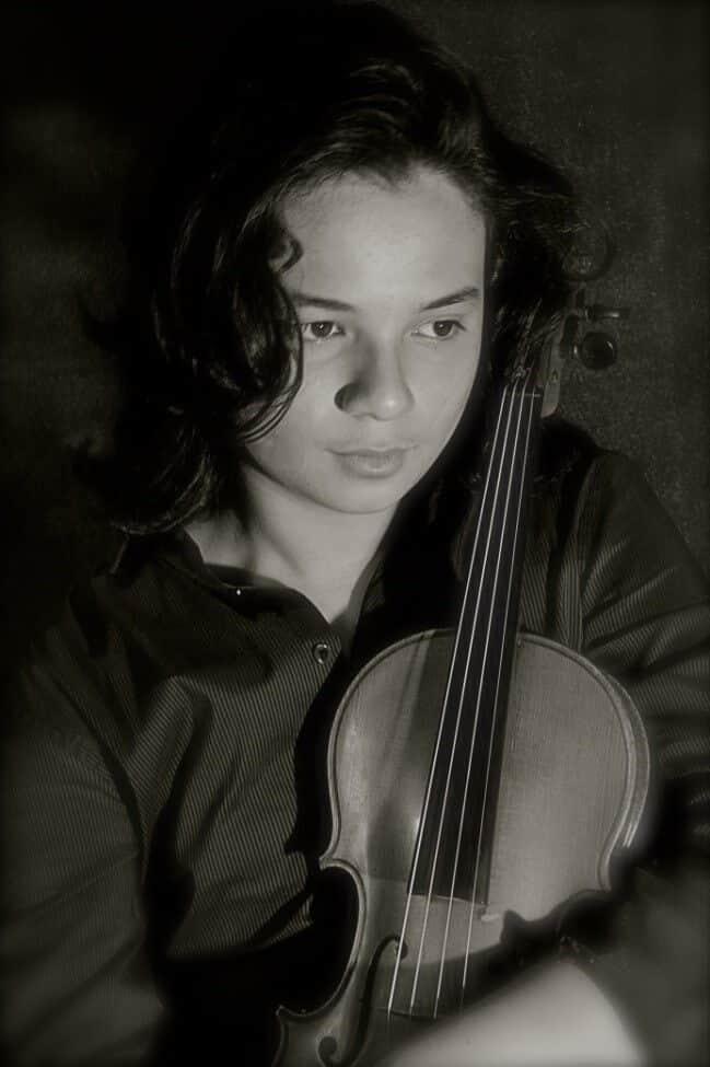 autism aspergers story inspiring kid holding violin