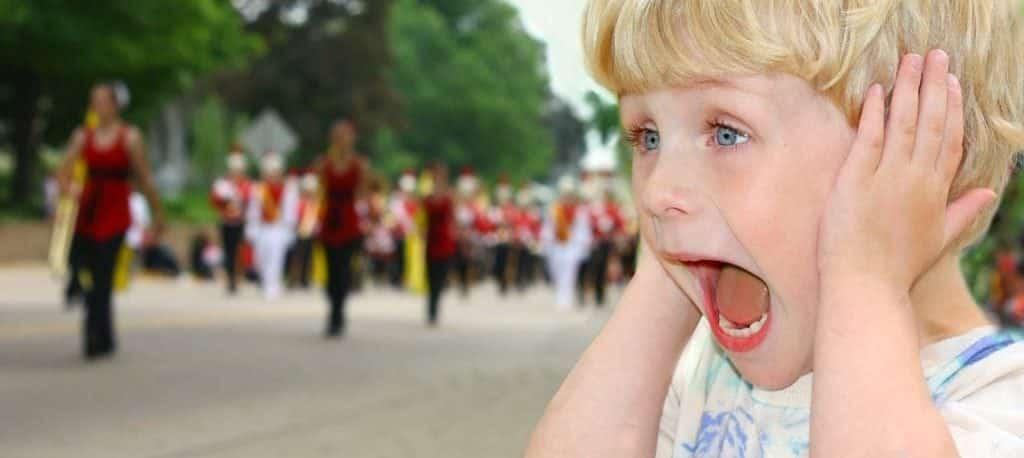 child covering ears autism sound sensitivity