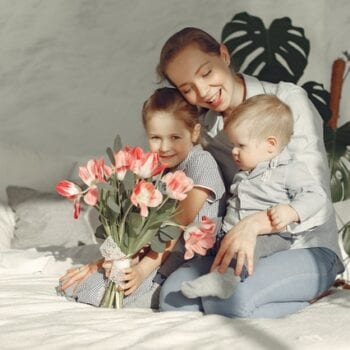mother with children sitting on bed at home 3875143   Tomatis Australia